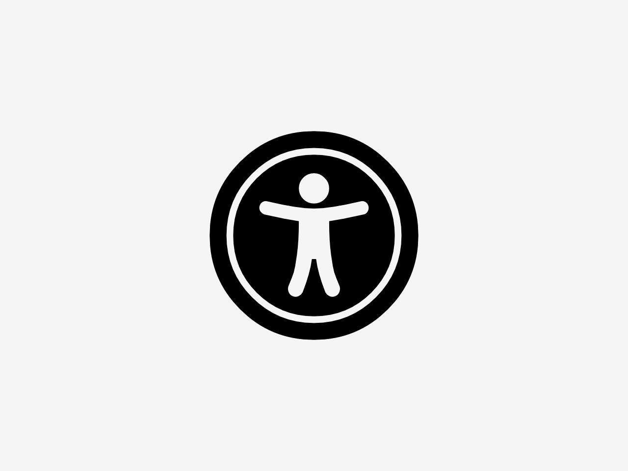 Bild zeigt ein Symbol für Barrierefreiheit. Das Symbol zeigt einen Kreis, indem ein Mensch mit geöffneten Armen und Beinen abgebildet ist.